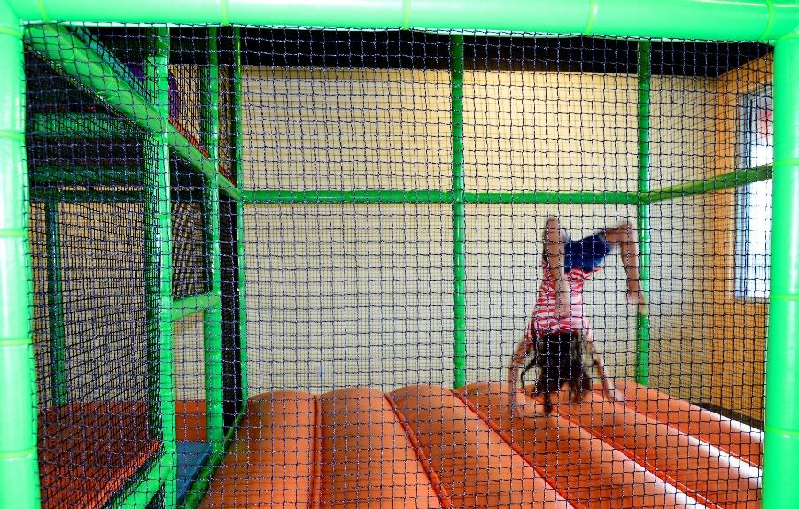 a girl playing in an indoor party venue