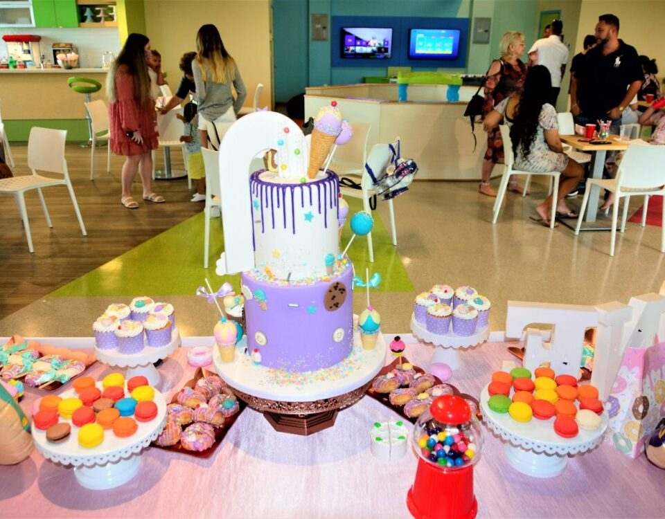 Colorful macaroons and customized cake on the table