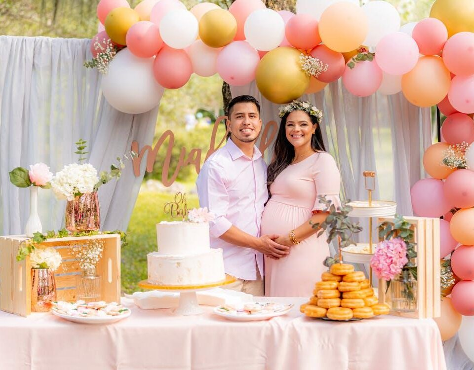 A pregnant couple celebrating their baby shower